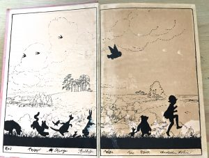 """Photo of pages from a first edition of 1928's """"The House on Pooh Corner."""""""