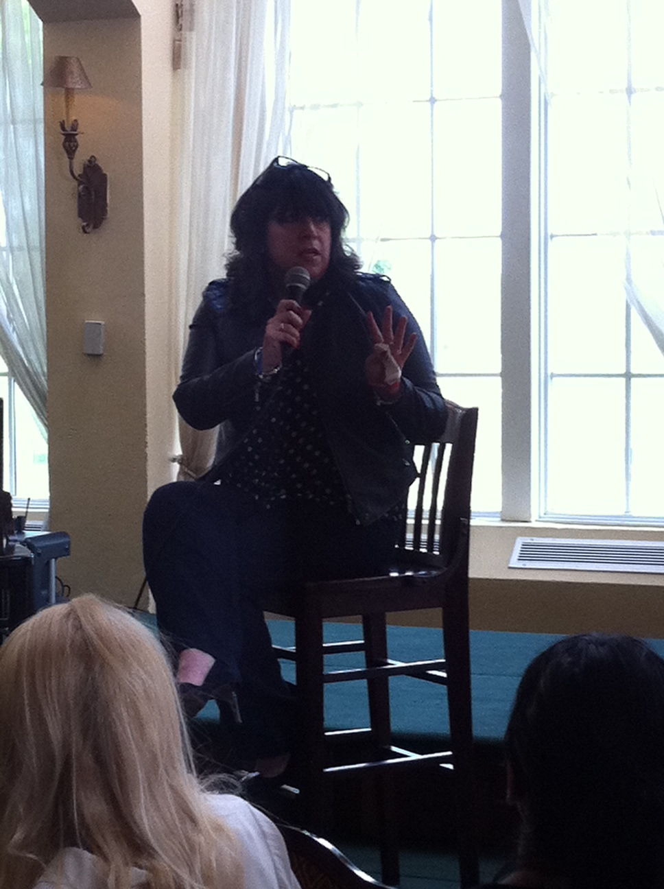 Photo of E. L. James speaking to a crowd.