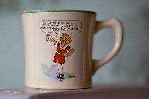 Phoro of a mug showing Little Orphan Annie.