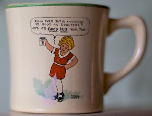 Photo of a coffee mug showing Little Orphan Annie.