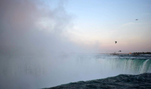 A photo of Niagara Falls at sunset.