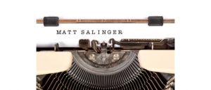 A typewriter with the name Matt Salinger typed on white paper.