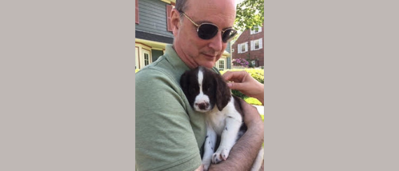 A.M. Juster holding his puppy, Sadie.